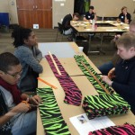 Volunteers working on fleece scarves