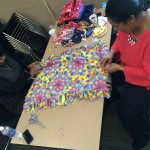 Volunteers working on fleece blanket