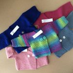 Beautiful hand-knitted baby sweaters